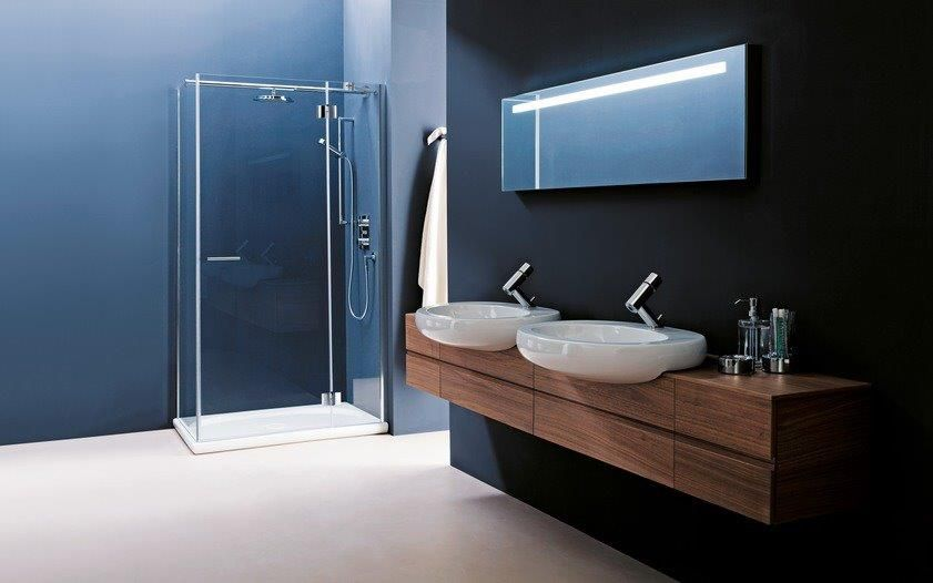 Bathroom in dark blue with wood effect sinks